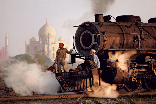 Taj and Train. Agra, Uttar Pradesh, India, 1983. © Steve McCurry