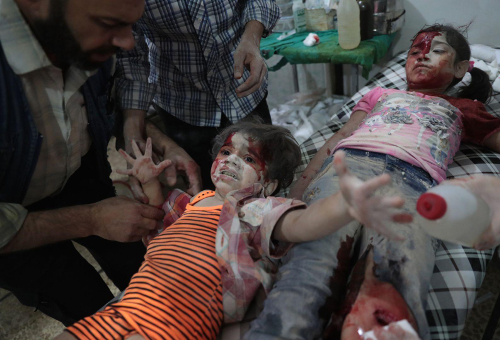 Abd Doumany Medics Assist a Wounded Girl