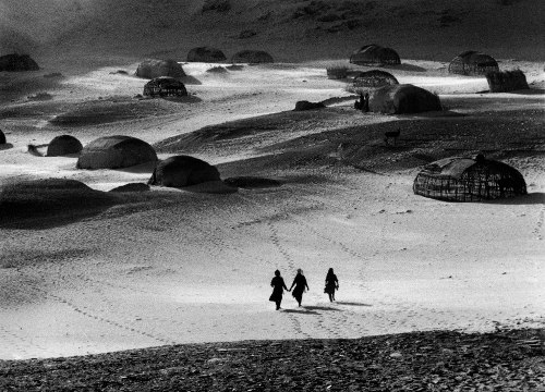 Raymond Depardon A group walking across the land of Tigui. Borkou, Chad. 1979. © Raymond Depardon